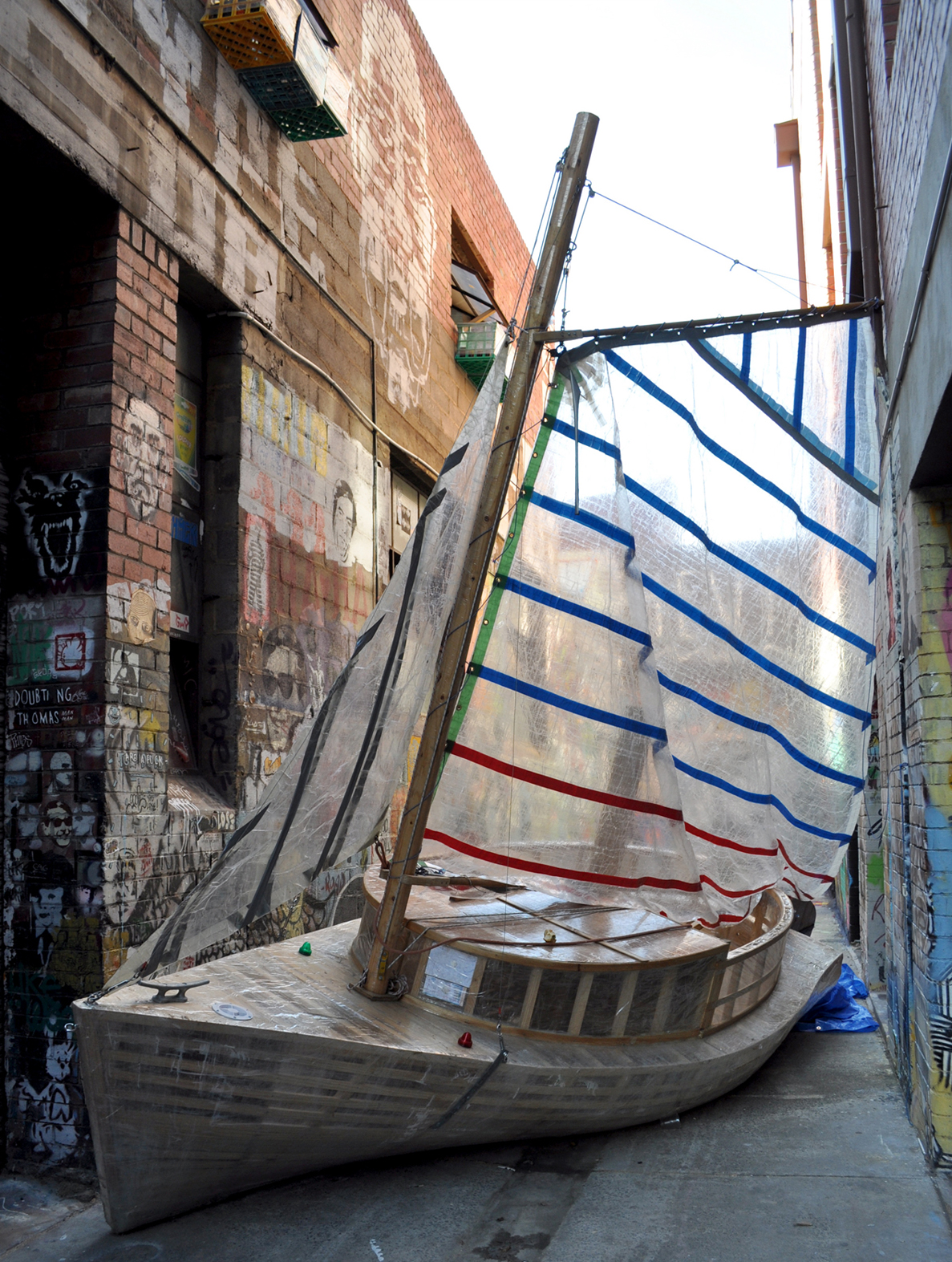2/3/10-One of the best things to do in Melbourne is walk through its alley ways. You never know what you'll find, like this sailboat made of wood and tape, which I found in an alley way off Victoria Street. Photo by Bobbi Lee Hitchon